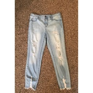 Distressed acid washed ripped jeans